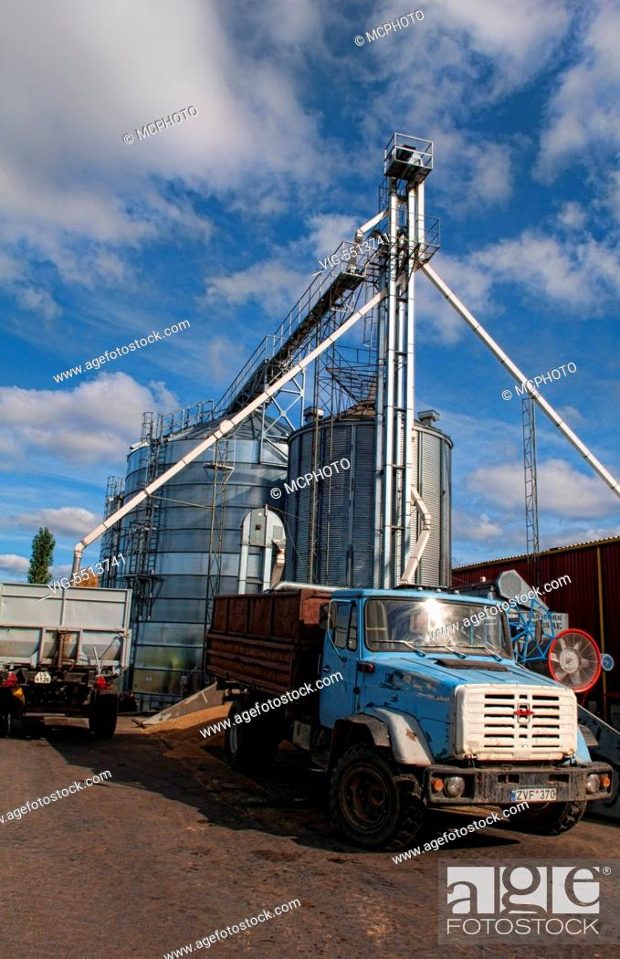 Imagen: Lithuania improvements industry farming with colorful company of wheat farming storage area with trucks in Vaunas Lithuania - 01/10/2015.