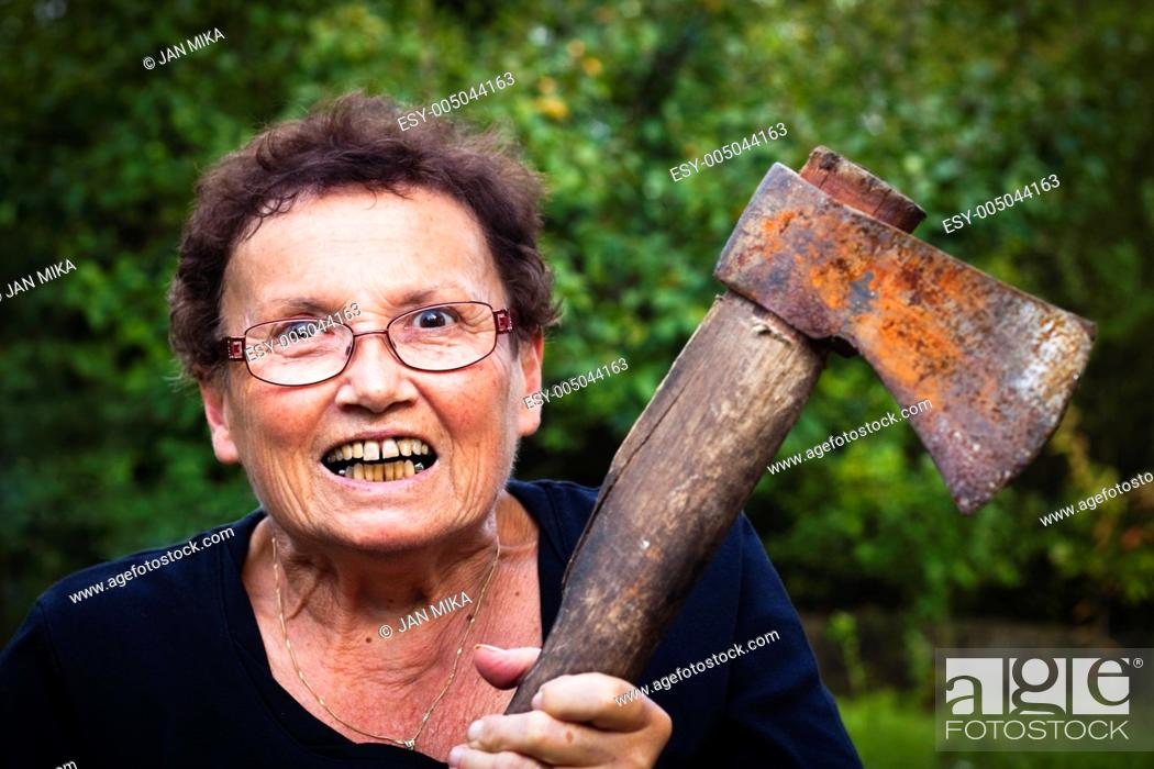 Crazy senior woman holding axe, Stock Photo, Picture And Low Budget