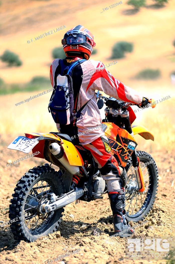 Stock Photo: Doing motocross rider.