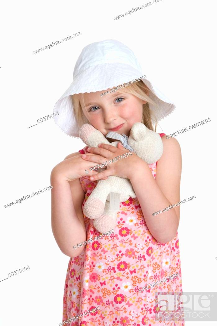 Stock Photo: Portrait of a blond girl with a hat and toy animal.