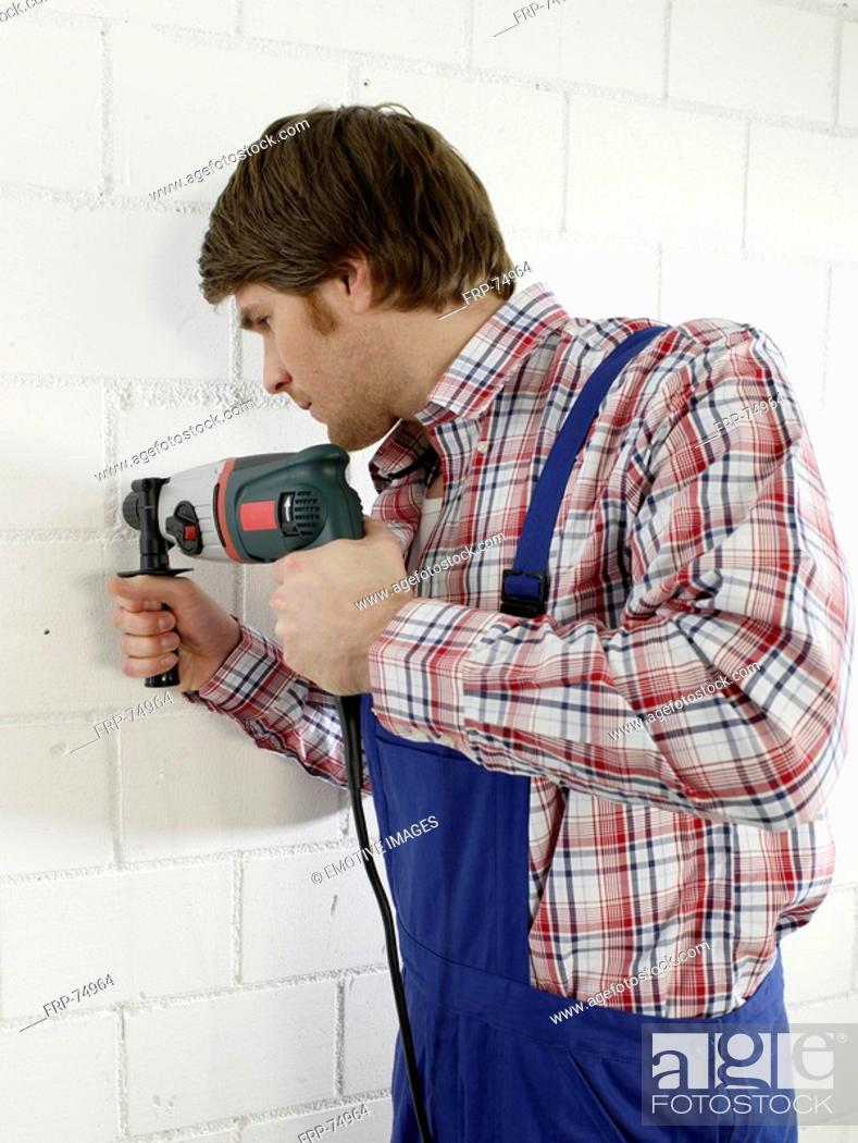 Stock Photo: Man is using a driller.