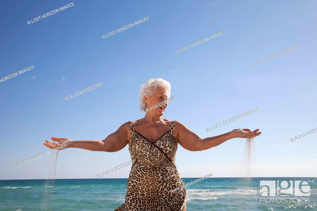 Stock Photo: Senior Woman on the beach.