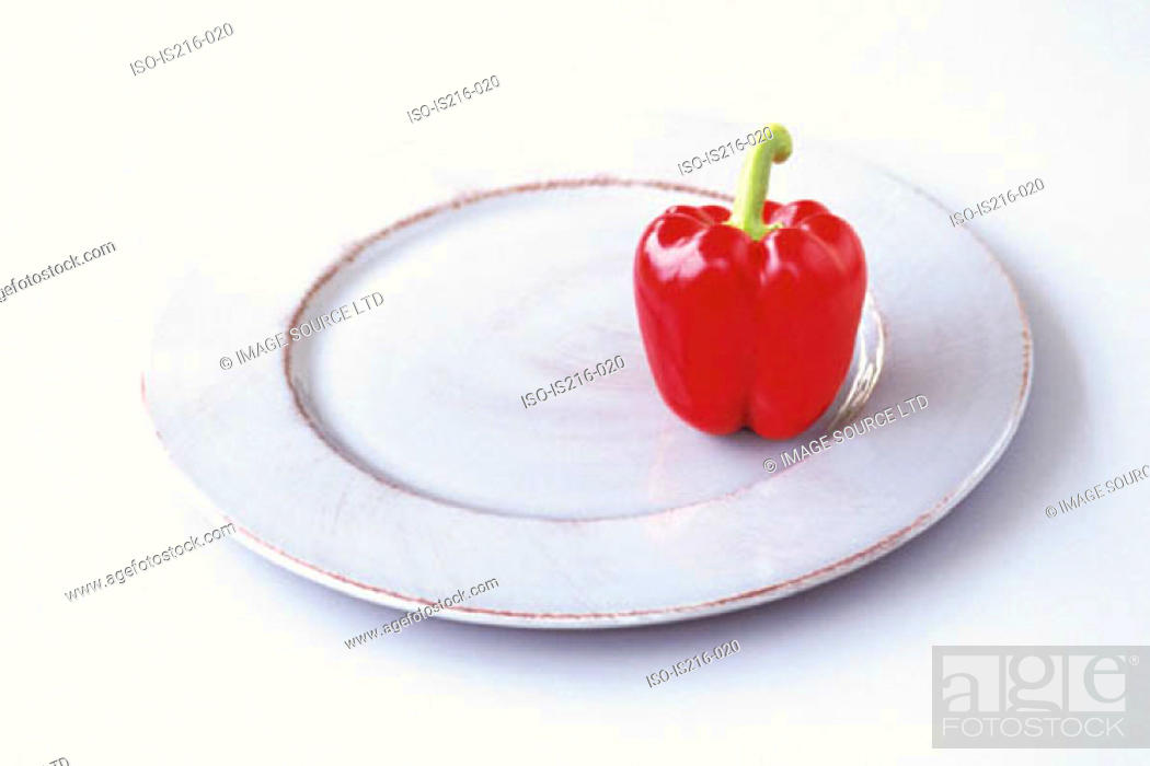Stock Photo: Pepper on a plate.