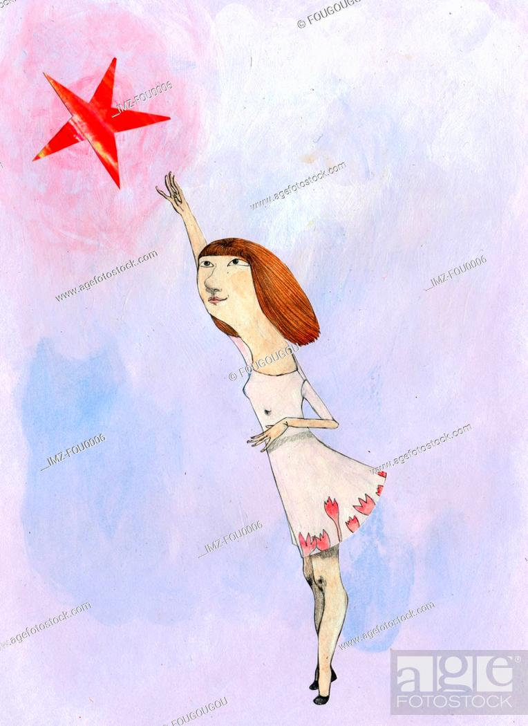 Stock Photo: A young girl reaching for a star.