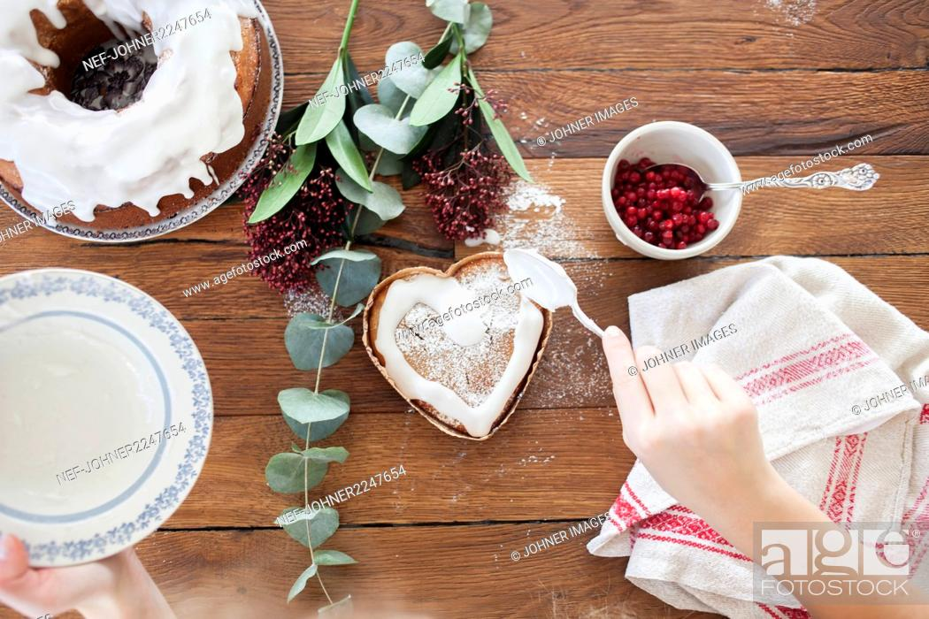 Stock Photo: Girl making a cake.