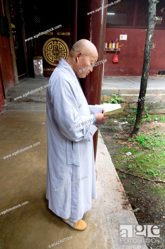 Stock Photo: A Buddhist monk in Kaiyan temple in Chaozhou.