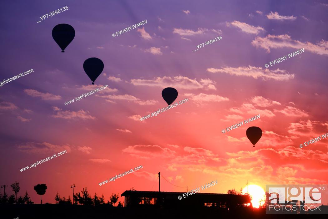 Stock Photo: Hot air balloons silhouette in Goreme valley at sunrise, Cappadocia, Turkey.