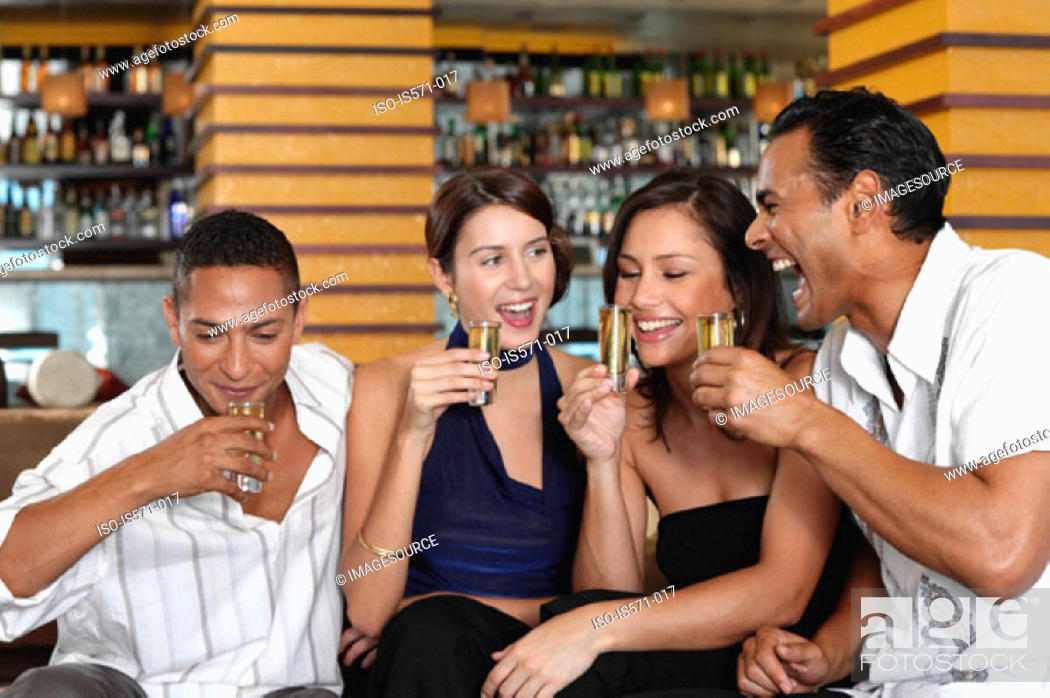Stock Photo: Friends drinking in bar.