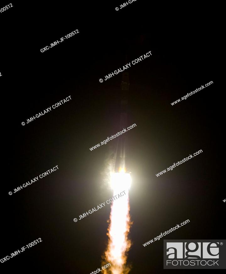 Stock Photo: The Soyuz TMA-03M rocket launches from the Baikonur Cosmodrome in Kazakhstan at 7:16 p.m. (Kazakhstan time) on Dec. 21, 2011 carrying Expedition 30 Soyuz.