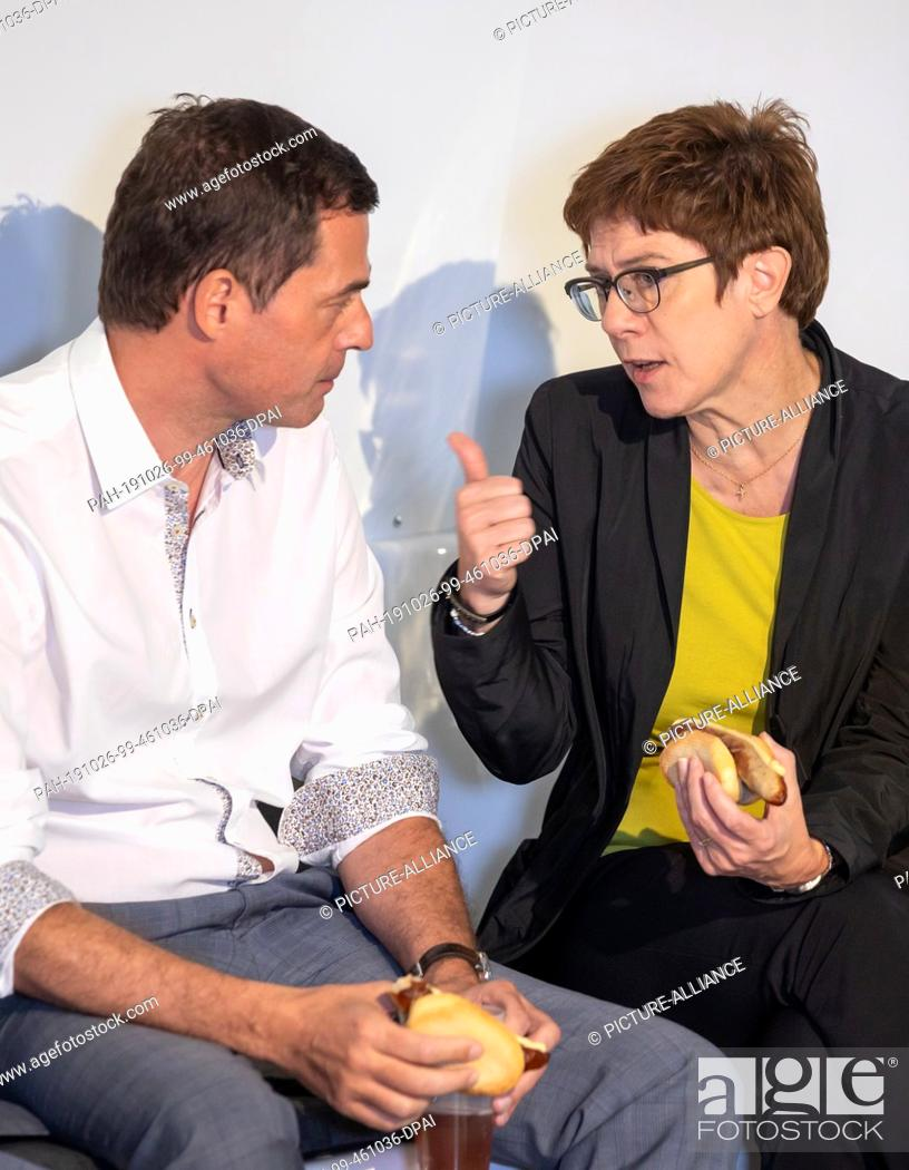 Stock Photo: 26 October 2019, Thuringia, Erfurt: Mike Mohring, CDU's top candidate for the state elections, talks with the federal chairman Annegret Kramp-Karrenbauer at a.