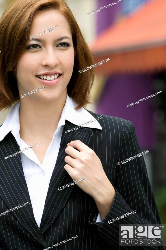 Stock Photo: Close-up of a businesswoman smiling.