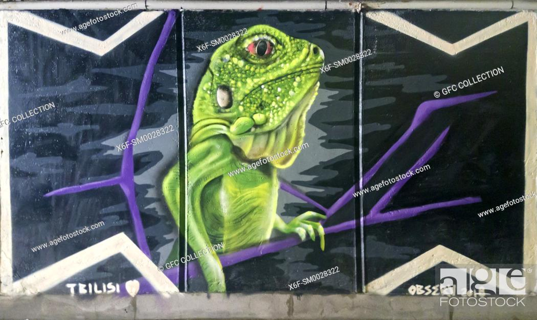Stock Photo: Green reptile, graffiti, underground passway Baratashvili Bridge, Tbilisi, Georgia.