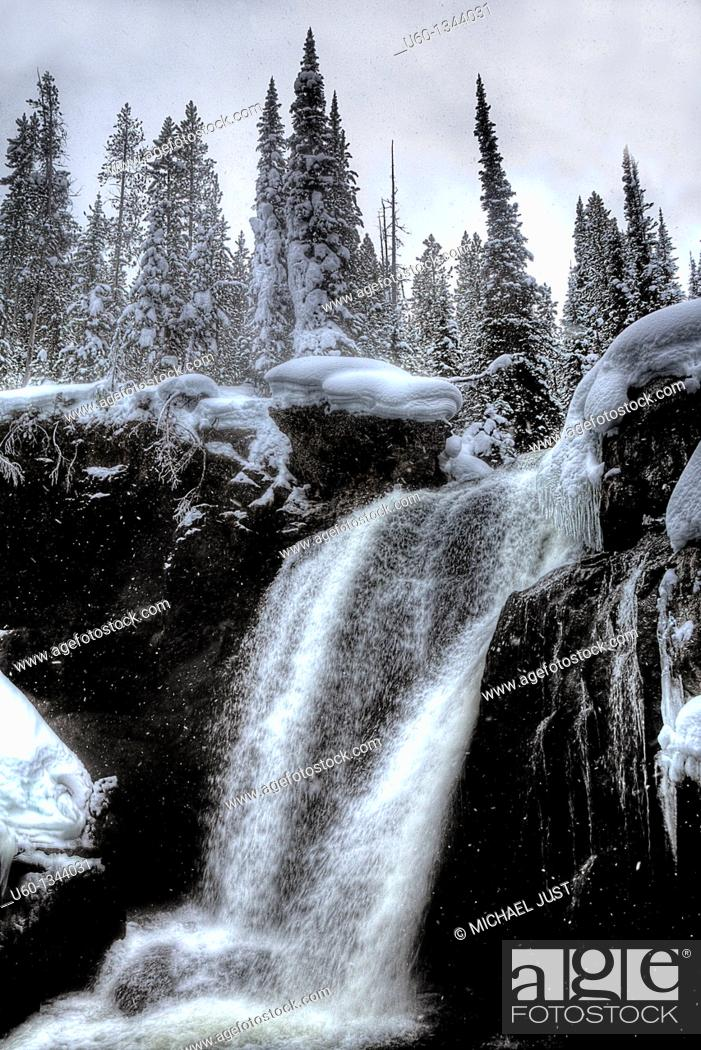 Stock Photo: Moose Falls flows during the winter at yellowstone National Park, Wyoming.