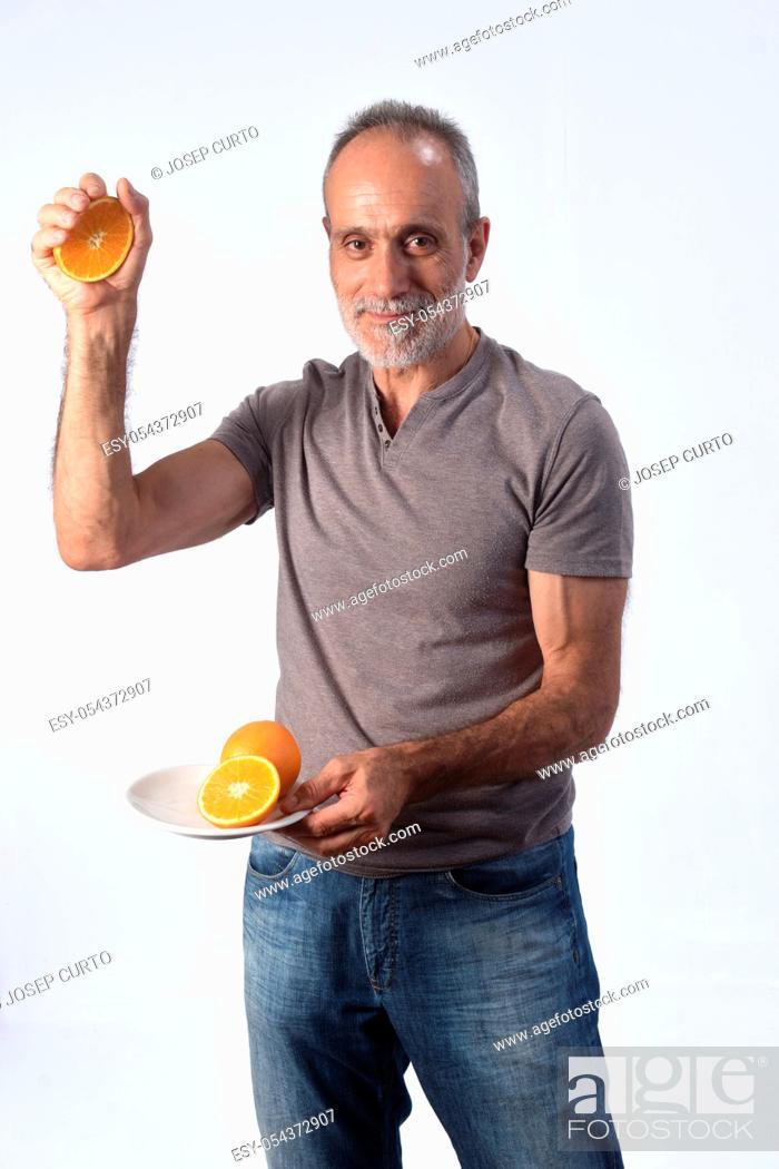 Photo de stock: man with orange fruit on white background.