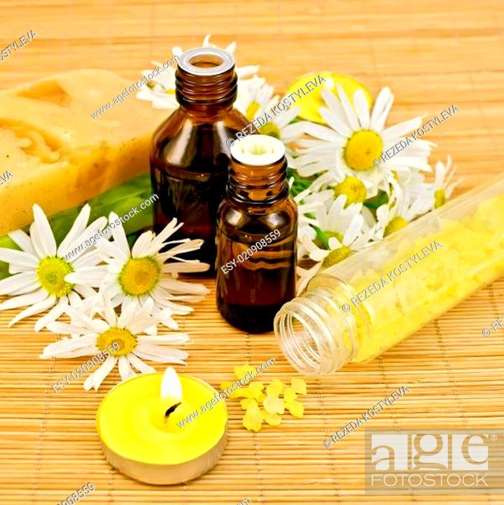 Stock Photo: Oil yellow with soap and candles.