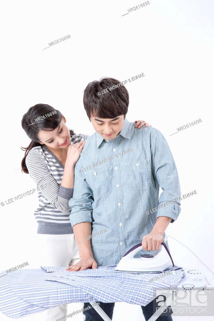 Imagen: Loving young newlyweds ironing.