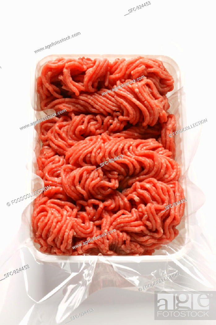 Stock Photo: Fresh minced beef in plastic container.
