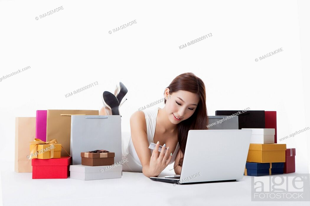 Stock Photo: Young woman using laptop and credit card for online shopping,.