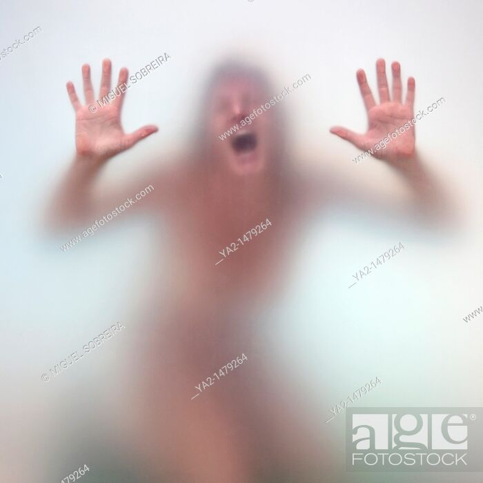 Stock Photo: Naked captive woman in anguish.