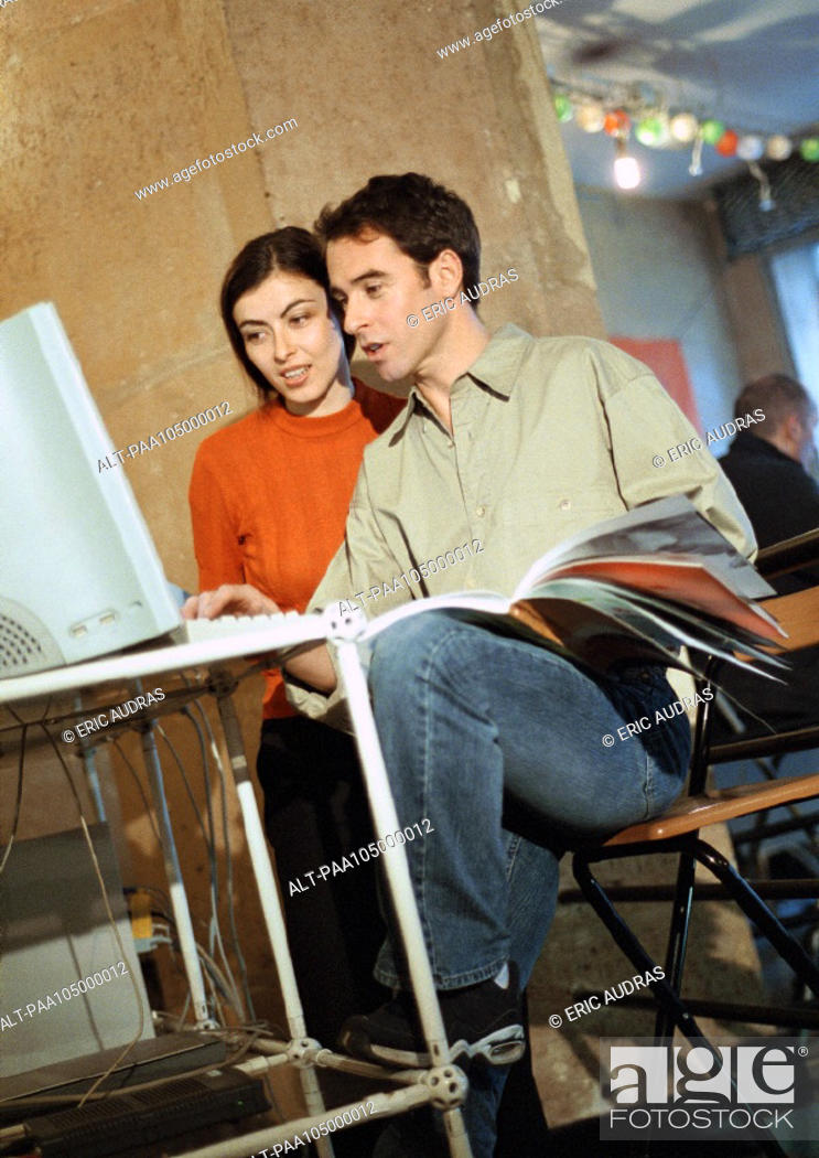 Stock Photo: Man and woman looking at computer.