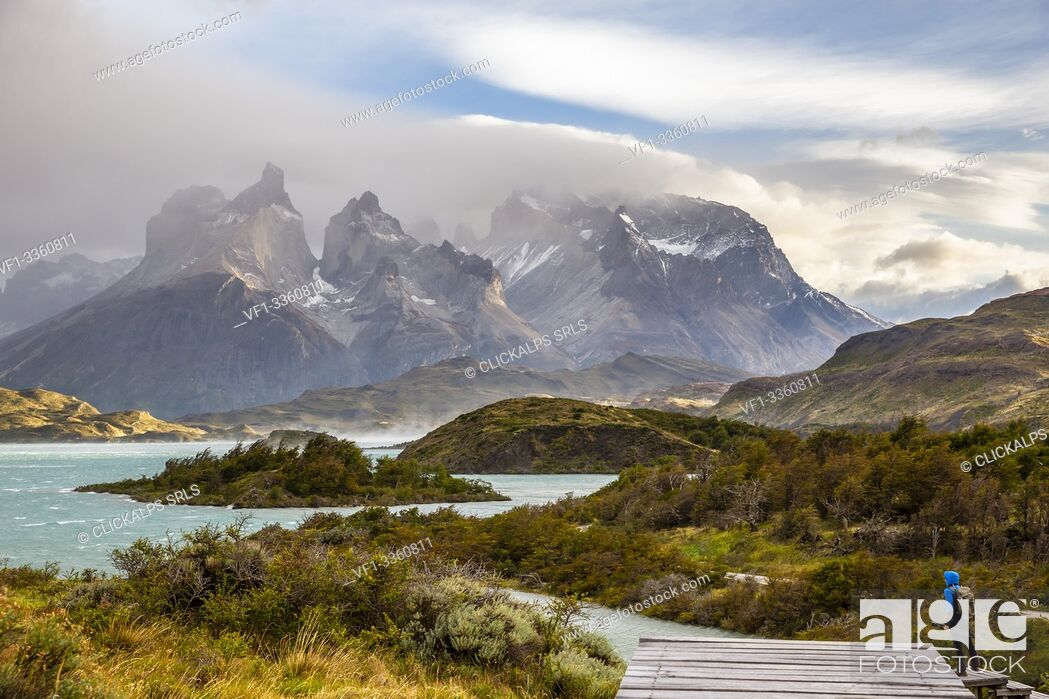 Stock Photo: Chile, Patagonia, Magallanes and Chilean Antarctica Region, Ultima Esperanza Province, Torres del Paine National Park, a man admires the Paine Horns.