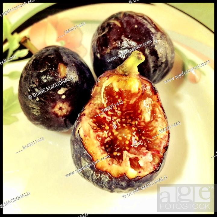 Stock Photo: Fresh figs on a plate.