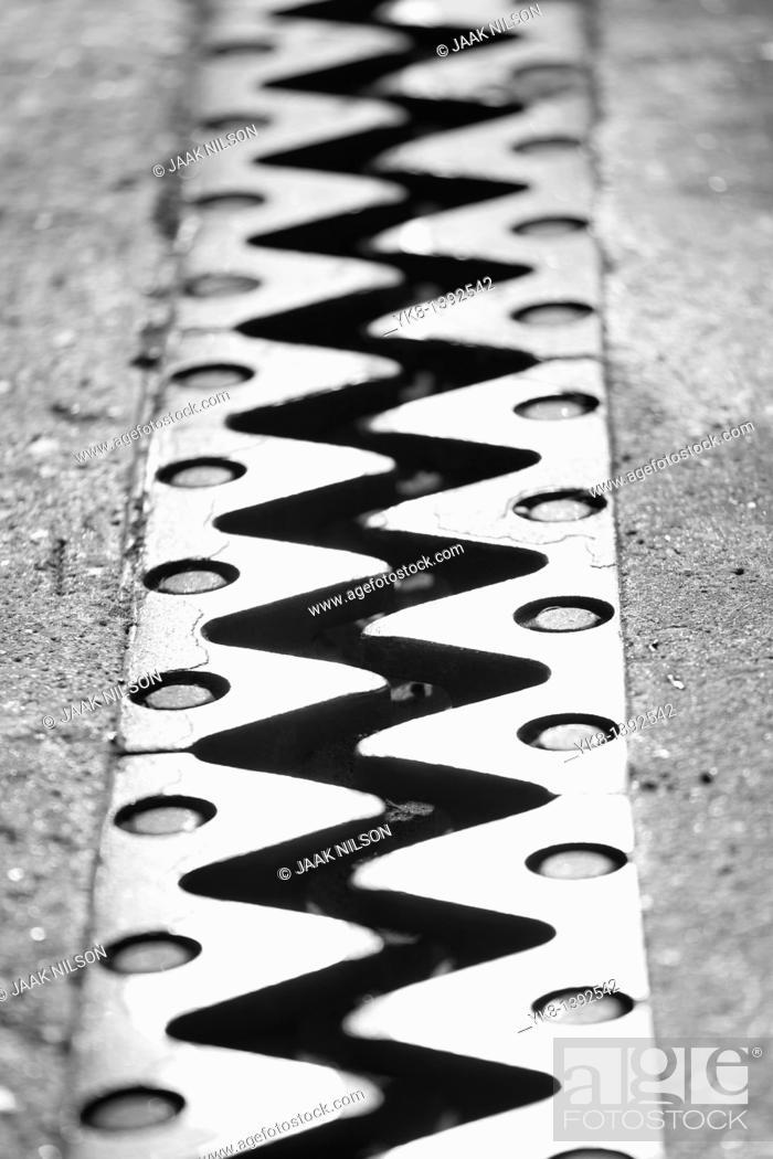 Stock Photo: Bridge Fingers, Metal Teeth Construction Between Road and Bridge Expansion Joint.