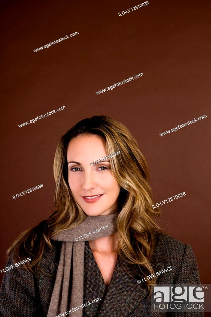 Stock Photo: Portrait of a mid adult woman wearing an autumnal scarf and jacket.