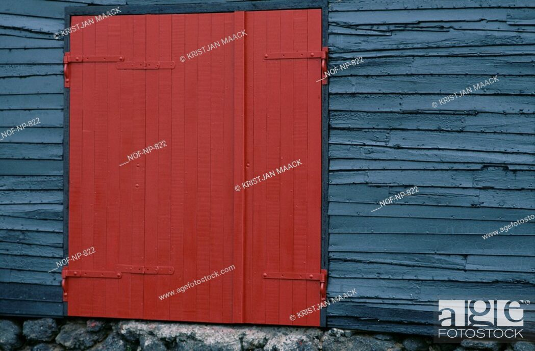 Stock Photo: Bright red wooden door on the side of grey wooden structure.