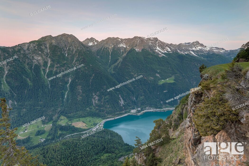 Stock Photo: Overview of rocky peaks and lake at dawn, San Romerio Alp, Brusio, Canton of Graubünden, Poschiavo valley, Switzerland.