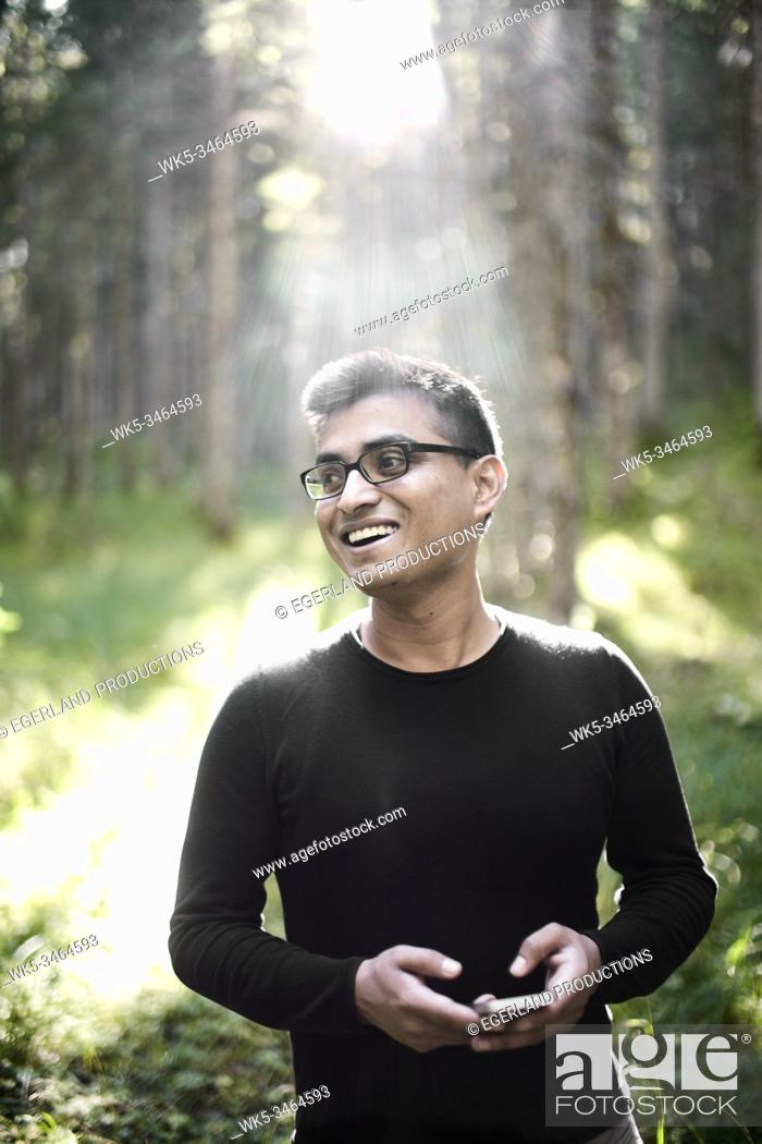 Stock Photo: Asian man enjoying the environment in forest. Eibsee, Bavaria, Germany.