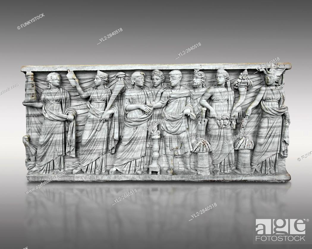 Stock Photo: Roman relief sculpture on a sarcophagus side showing a married couple with pagan deities, circa 270 - 280 AD from the via Latina, Rome, Italy.