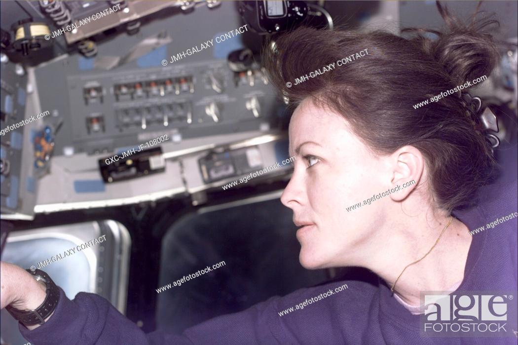 Stock Photo: Astronaut Janet L. Kavandi, mission specialist, supports the Shuttle Radar Topography Mission (SRTM) during Red Team duties on Endeavour's aft flight deck.