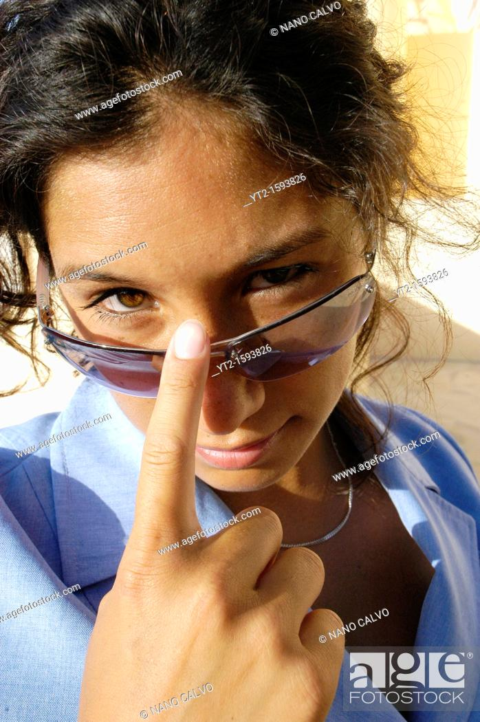 Stock Photo: Cute young executive woman in her twenties, half asian half spanish, wearing sunglasses.