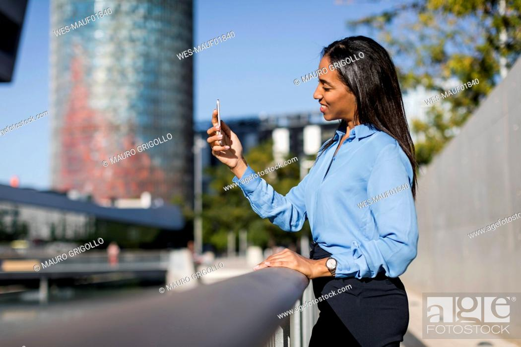 Stock Photo: Businesswoman using smartphone.