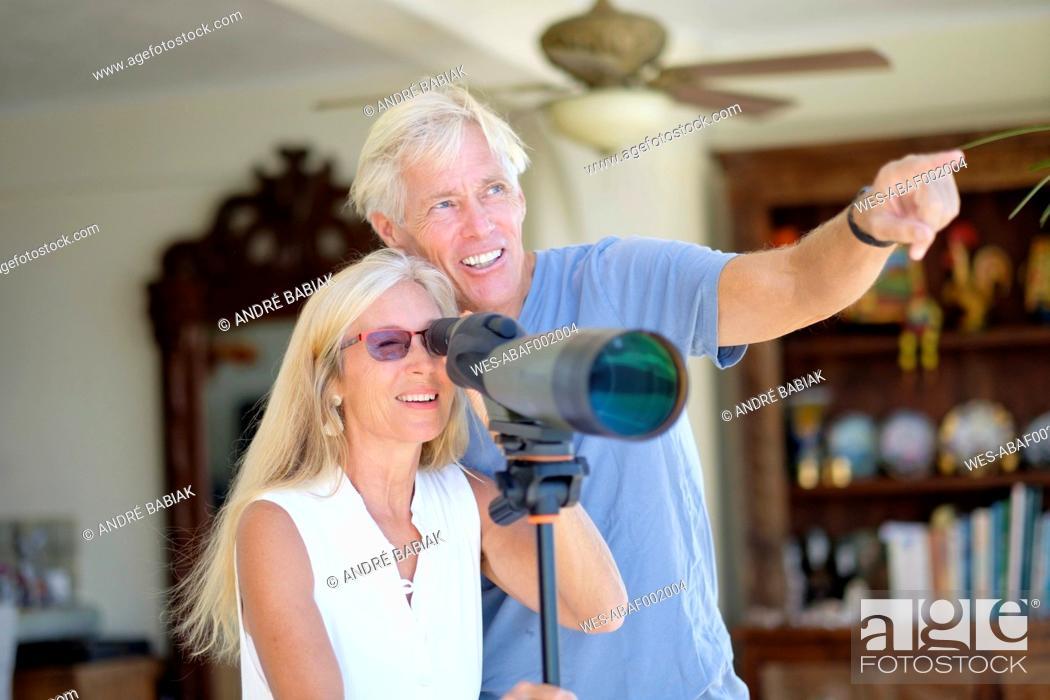 Photo de stock: Senior couple looking through telescope.