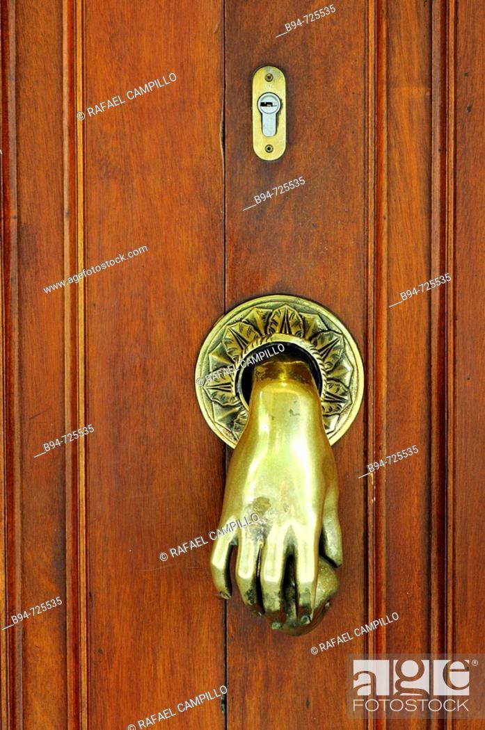 Stock Photo: Knocker and lock at Gran de Gracia 116, Barcelona. Catalonia, Spain.