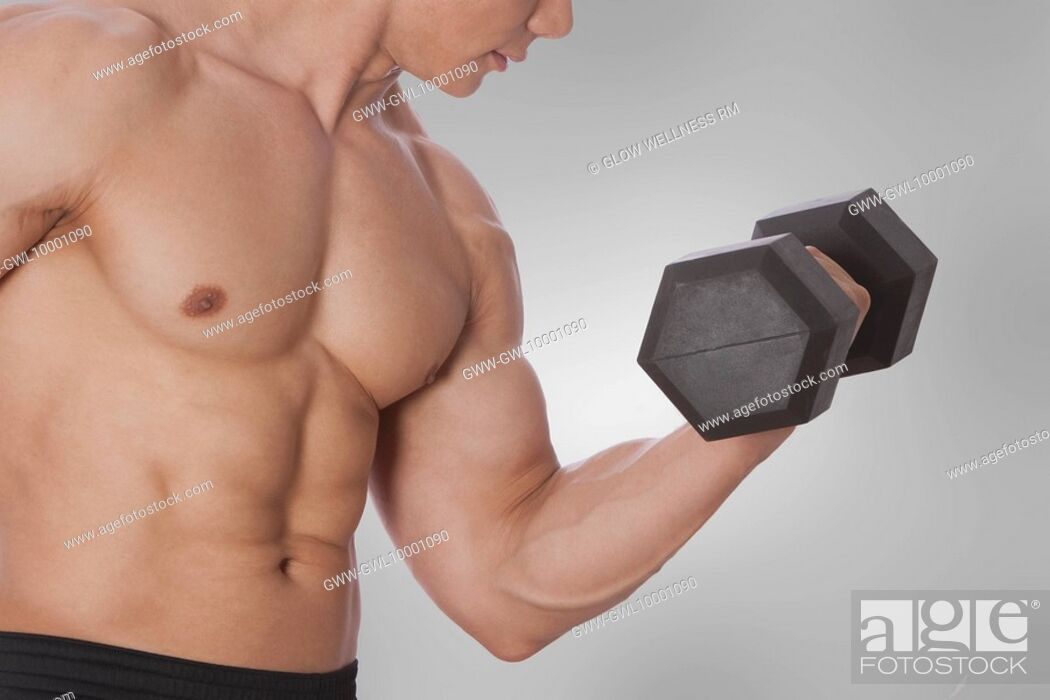 Stock Photo: Man exercising with a dumbbell.