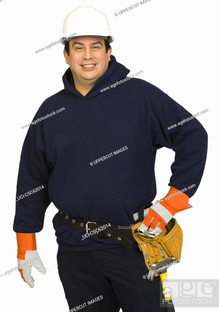Stock Photo: Male construction worker wearing hard hat.