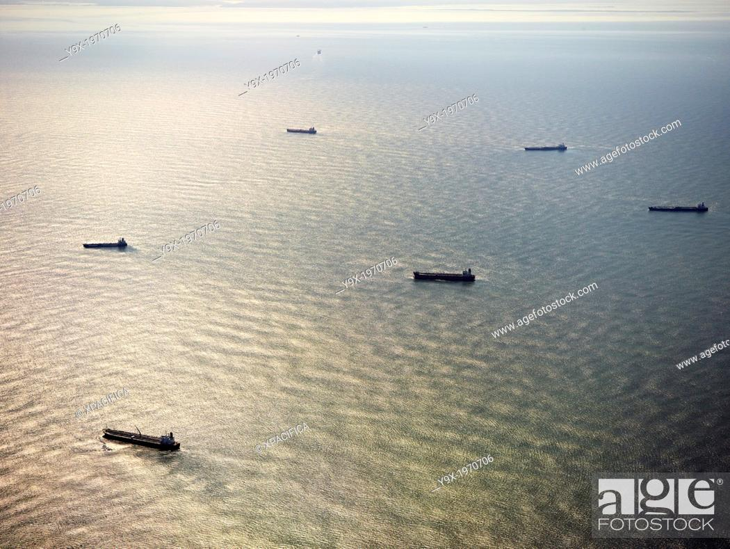 Stock Photo: Cargo ships floating in the ocean.