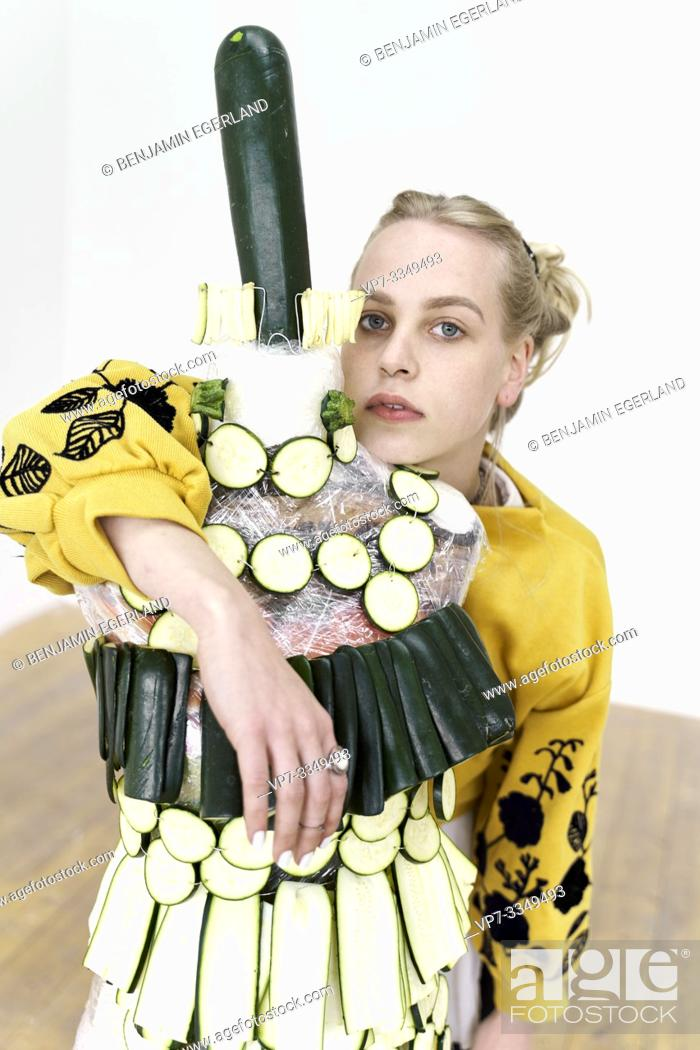 Stock Photo: young woman with artistic fashion dress made of raw zucchini.