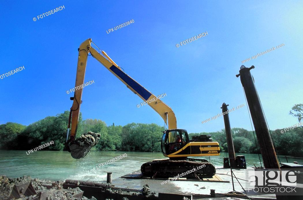 Stock Photo: Excavator during dredging excavations.