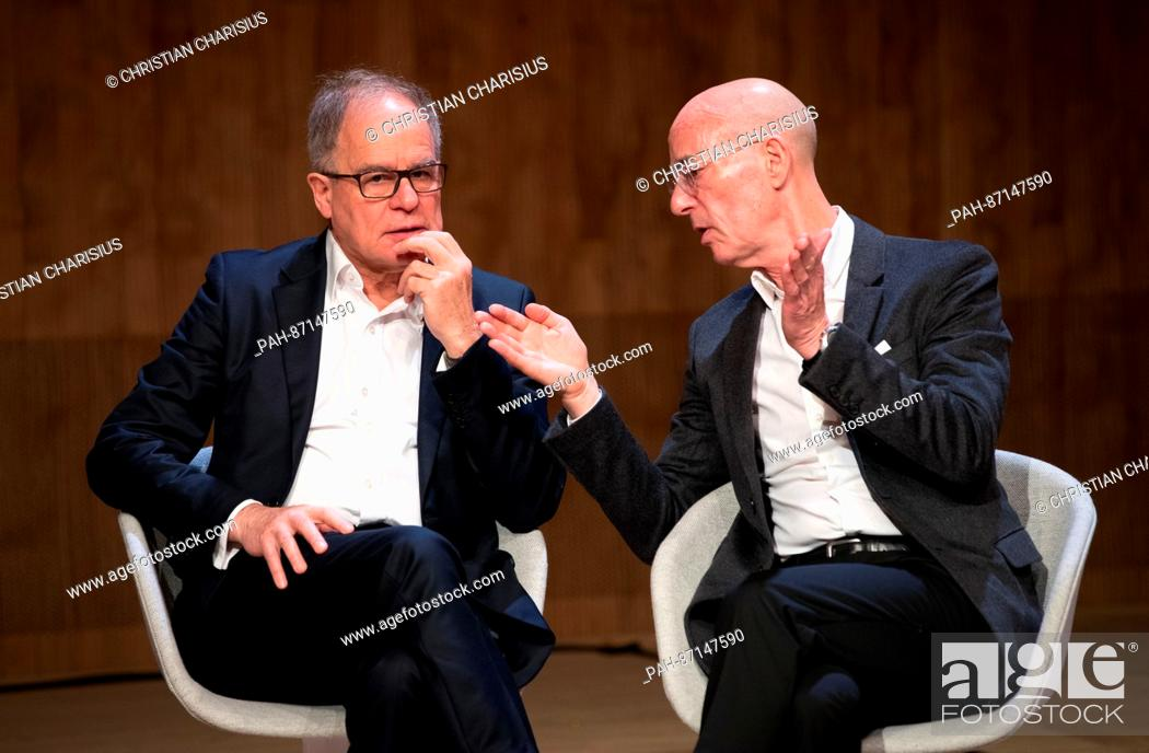 Stock Photo: The architects Pierre de Meuron and Jacques Herzog from the architect's office Herzog & de Meuron speak during a press conference in the small hall of the.