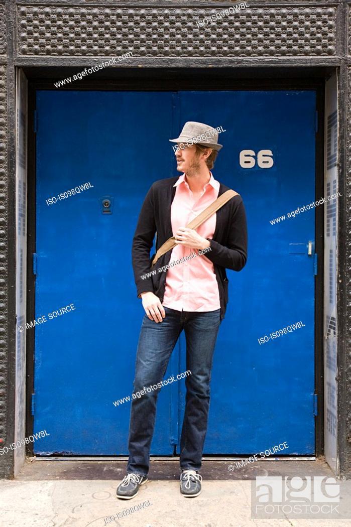 Stock Photo: Young man by door.