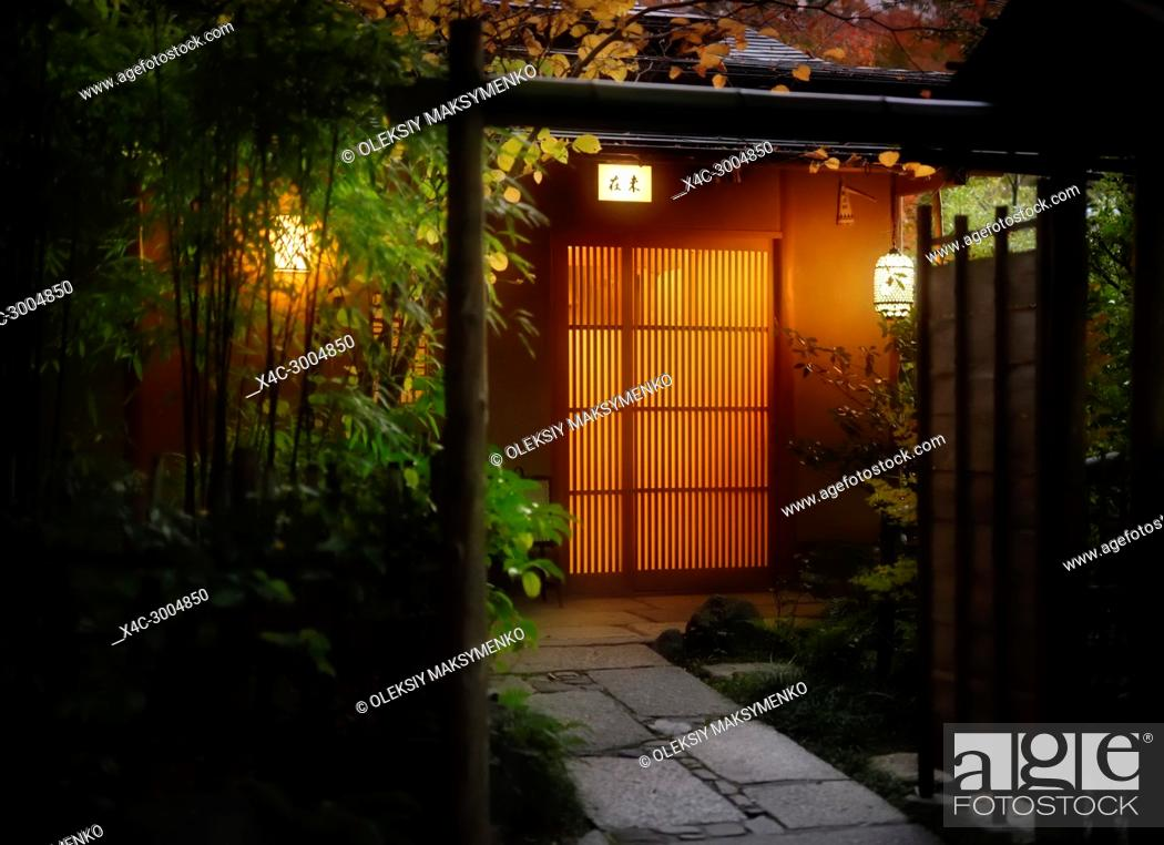 Stock Photo: Illuminated with lanterns entrance door of Mizai, traditional Japanese Kaiseki restaurant in the evening. Higashiyama, Kyoto, Japan.
