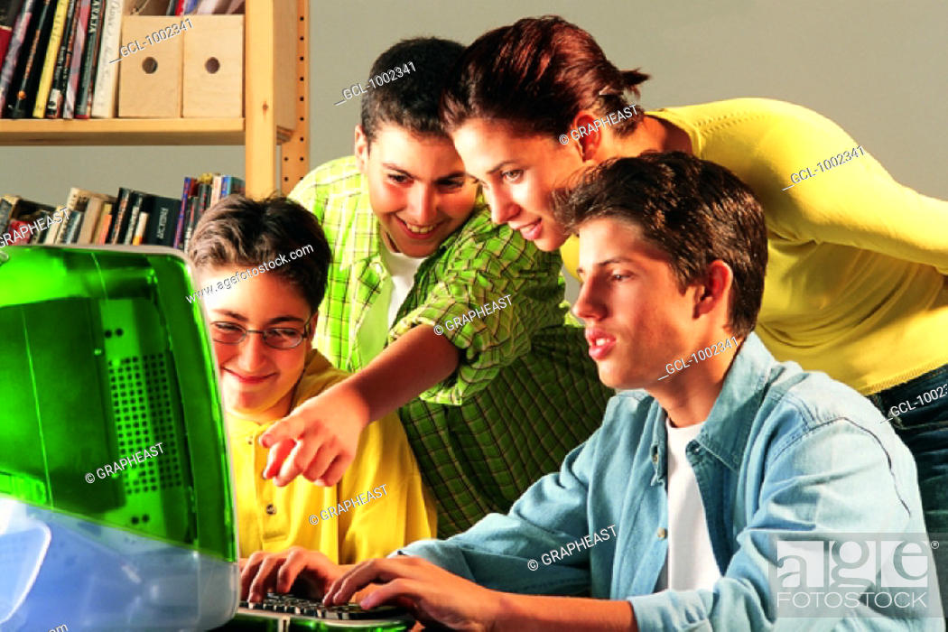 Stock Photo: Group of pupils and mother at computer.