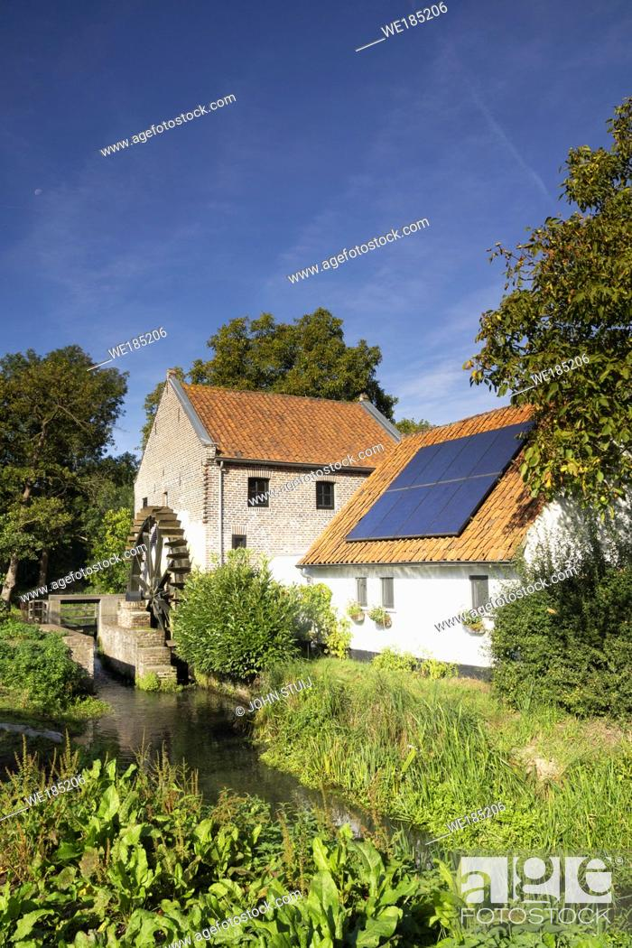Stock Photo: The Schouwsmolen is a watermill on the Itterbeek river in the Dutch village Ittervoort.