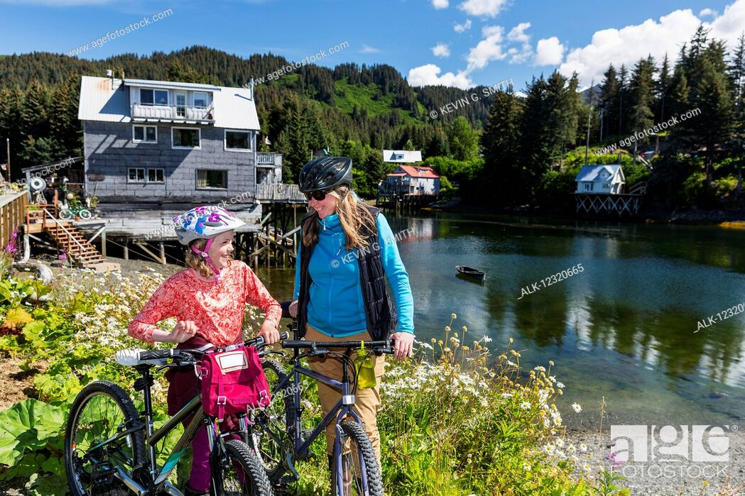 Imagen: Mother and daughter with bicycles next to the Seldovia Slough on a sunny day, Southcentral Alaska, USA.
