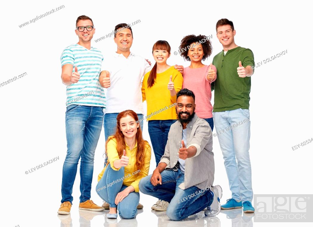 Stock Photo: diversity, race, ethnicity and people concept - international group of happy smiling men and women showing thumbs up over white.