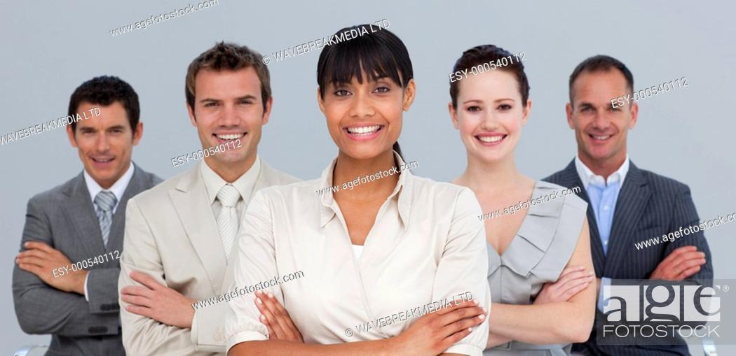 Stock Photo: Smiling multi-ethnic young business team with folded arms.